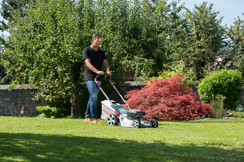 Lawnmower from IKRA in action when mowing the lawn